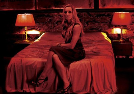 Kristin-Scott-Thomas-sitting-on-a-bed-in-Only-God-Forgives